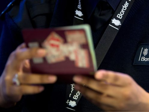 Border Force is 'choosing' not to fully staff airport arrival halls where passengers are being forced to wait in long queues, a trade body has claimed (Steve Parsons/PA)