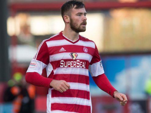 Skipper Scott McMann has urged Hamilton to grasp their Scottish Premiership lifeline after the 2-1 win against St Mirren (Jeff Holmes/PA Images).