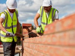 The UK's construction sector led the FTSE 100 on Friday (Taylor Wimpey/PA)