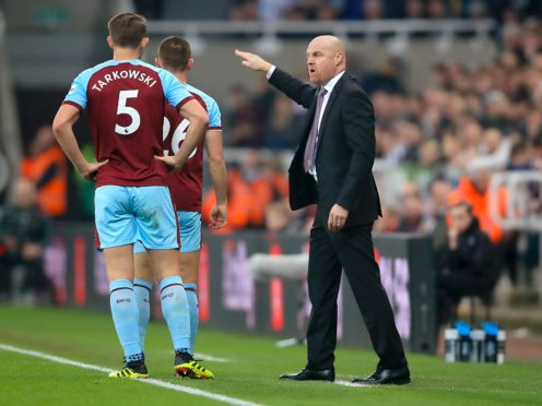 Sean Dyche, right, expects James Tarkowski to stay at Burnley this summer (Owen Humphreys/PA)
