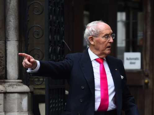 Sir Frederick Barclay (left) leaves the High Court in London, after a preliminary hearing in his row over money with Lady Hiroko Barclay (Kirsty O'Connor/PA)