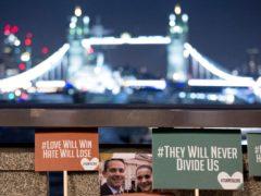 Tributes to Jack Merritt and Saskia Jones on London Bridge (Rick Findler/PA)