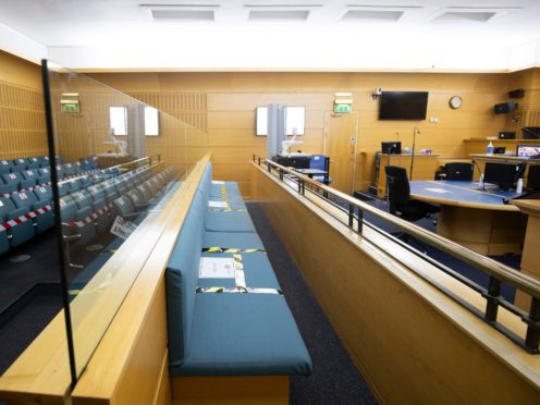 Social distancing and safety measures inside court (Jane Barlow/PA)
