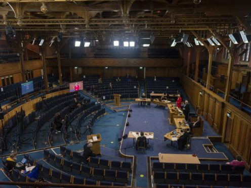 Ministers, elders, deacons and special guests are taking part in a 'blended' General Assembly for the second year running (Church of Scotland/PA)