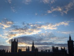 The sun sets behind the Houses of Parliament in Westminster, London (Victoria Jones/PA)