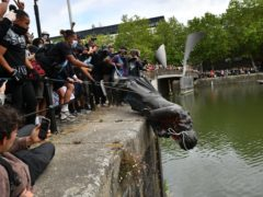Black Lives Matter protesters toppled the statue and rolled it into a dock in Bristol (Ben Birchall/PA)
