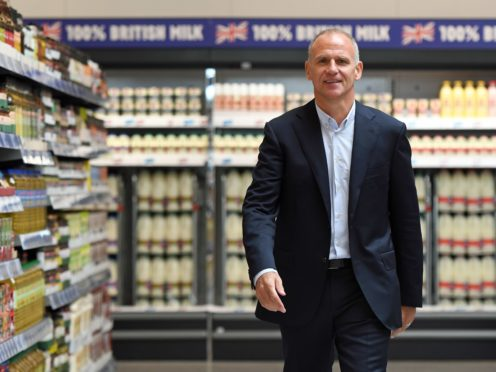 Sir Dave Lewis received £1.7 million from Tesco in its latest annual report (Joe Giddens/PA)