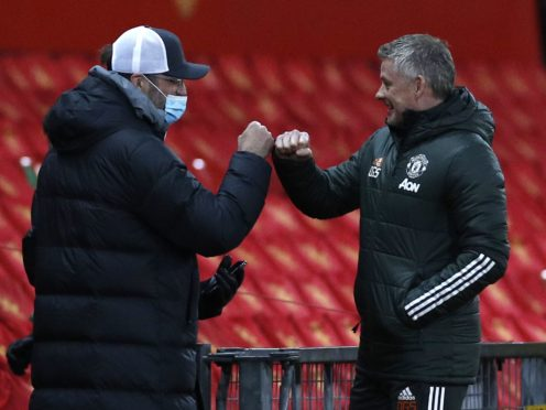 Liverpool manager Jurgen Klopp needs Manchester United manager Ole Gunnar Solskjaer to do him a favour in the race for the top four (Phil Noble/PA)