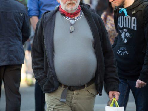 An obese man (Daniel Leal-Olivas/PA)