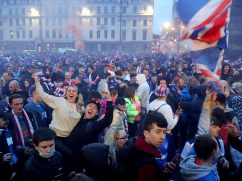 Rangers fans celebrate in George Square in March (Jane Barlow/PA)