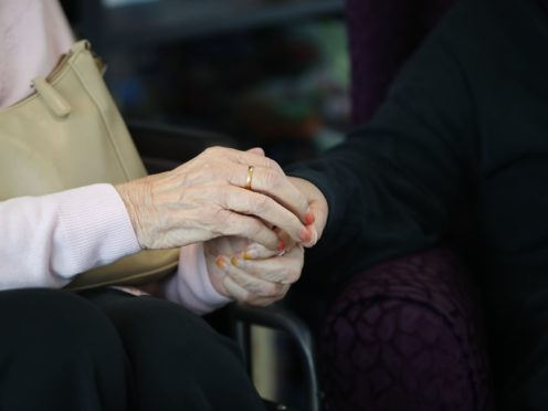 A care home resident is visited by her daughter in a care home in South London. (Aaron Chown/PA)