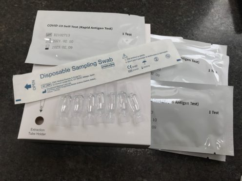 A package of seven NHS Test and Trace Covid-19 self-testing kits (Zoe Linkson/PA)