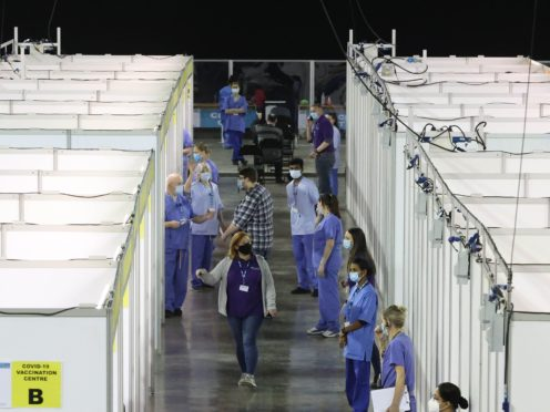 People attending a Covid-19 vaccination centre in the SSE Arena, Belfast (Liam McBurney/PA)