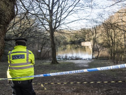 A Metropolitan Police officer at Wake Pond in Epping Forest, where Richard Okorogheye's body was found (Ian West/PA)