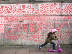 National Covid Memorial Wall on the Embankment in London (Victoria Jones/PA)