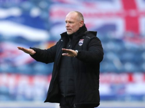John Hughes has warned that Ross County are not yet safe (Jane Barlow/PA)