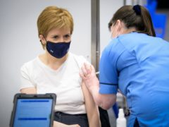 Nicola Sturgeon said the vaccination programme allowed Scotland to manage the pandemic 'less restrictively' (Jane Barlow/PA)