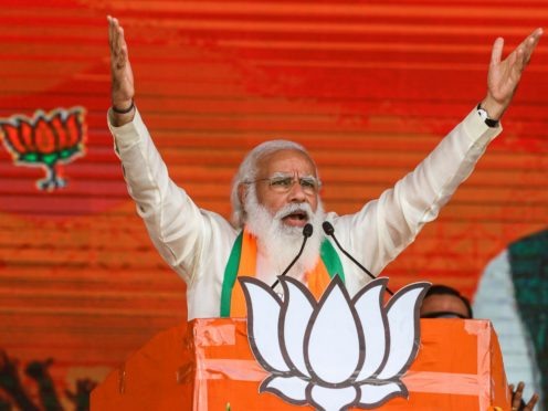 Indian Prime Minister Narendra Modi addresses a public rally ahead of West Bengal state elections in Kolkata, India (Bikas Das/AP)