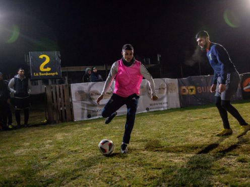 Players participate in the Midnight Ramadan League (Jacob King/PA)