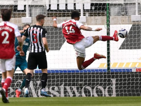 Arsenal's Pierre-Emerick Aubameyang (right) scores at Newcastle on his return to the starting line-up (Stu Forster/PA)