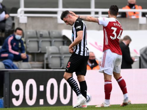 Newcastle's Fabian Schar leaves the pitch after being sent off (Stu Forster/PA)
