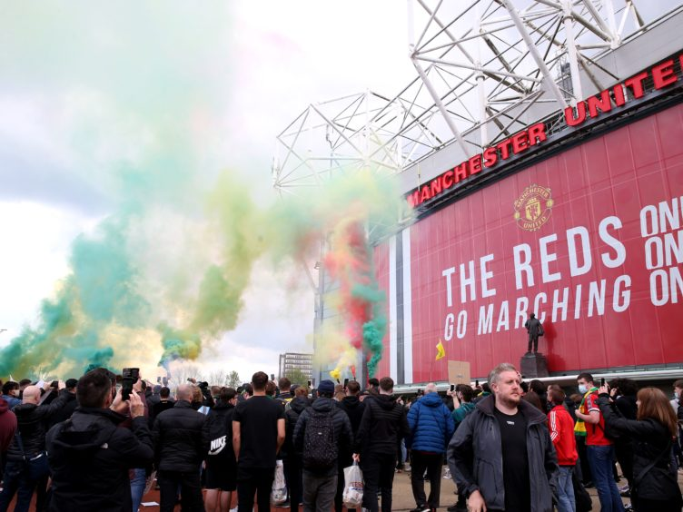 Fans let off flares (Barrington Coombs/PA)