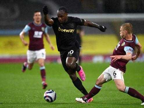 Michail Antonio (centre) inspired West Ham to a vital win at Burnley (Gareth Copley/PA)