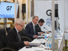 Foreign Secretary Dominic Raab sits between the Canadian minister of foreign affairs Marc Garneau and Japanese minister of foreign affairs Motegi Toshimitsu, during talks at the G7 Foreign and Development Ministers meeting at Lancaster House in London (PA)