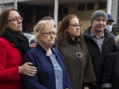 Joe McCann's family, (left to right) daughter Nuala, widow Anne, daughter Aine, and son Fergal, during a press conference outside Laganside Court in Belfast (Liam McBurney/PA)