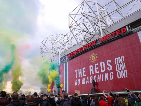Manchester United fans let off flares as they protest against the Glazer family (Barrington Coombs/PA)