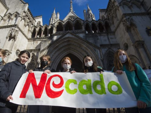 School children from Yerbury Primary School in Islington, north London, take part in a protest outside the High Court, London, against the building of a proposed Ocado depot near to their school. Ocado is going to the court seeking to overturn Islington Council's decision to revoke their licence to open a 24/7 distribution centre near to the primary school. Picture date: Wednesday May 5, 2021.