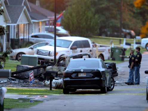 Police at the scene of the plane crash in Hattiesburg (Chuck Cook/AP)