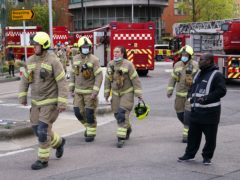 Firefighters at the scene in New Providence Wharf in London (Yui Mok/PA)