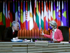 Lithuania's President Gitanas Nauseda, left, speaks with European Commission president Ursula von der Leyen during an EU summit round table meeting at the Crystal Palace in Porto, Portugal (Francisco Seco/Pool/AP)
