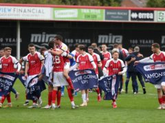 Cheltenham's players celebrate becoming League Two champions (Bradley Collyer/PA)