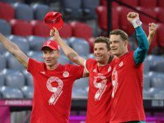 Robert Lewandowski (left), Thomas Muller (centre) and Manuel Neuer celebrate Bayern Munich's title win (Peter Kneffel/Pool via AP)
