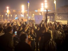 Crowds of people dance on the beach in Barcelona (Emilio Morenatti/AP)