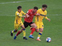 Tom Hopper (centre) battles for the ball (Mike Egerton/PA)