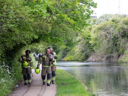Emergency services activity on the Grand Union Canal near Old Oak Lane (David Parry/PA)