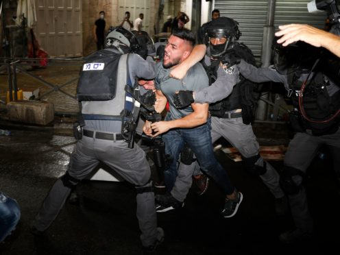 Israeli police have faced off with Palestinian protesters in east Jerusalem as the holy city's worst religious unrest in several years continued (Ariel Schalit/AP)