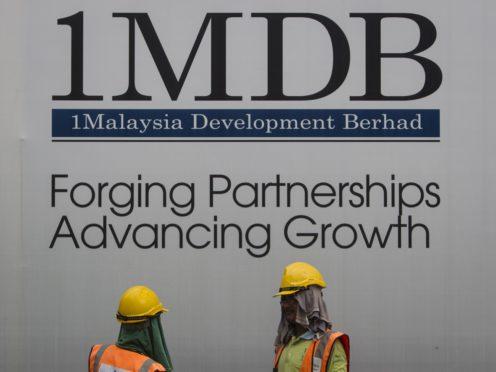 A billboard for state investment fund 1 Malaysia Development Berhad (1MDB) at the fund's flagship Tun Razak Exchange development in Kuala Lumpur (Joshua Paul/AP)