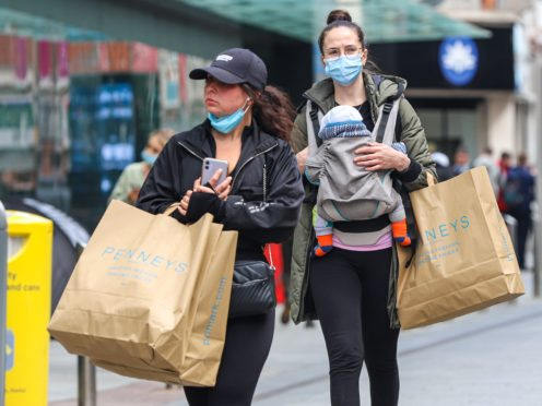 Shoppers with bags in Dublin City centre following the phased reopening of non-essential retail, with click-and-collect services and in-store shopping by appointment allowed, while close contact services, such as hairdressers, can resume in the latest round of easing restrictions in Ireland (Damien Storan/PA Wire)