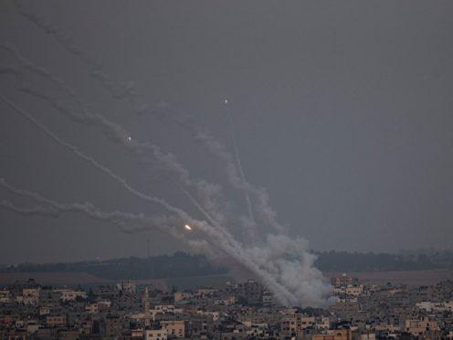 Rockets are launched from the Gaza Strip towards Israel, Monday, May 10, 2021. (AP Photo/Khalil Hamra)
