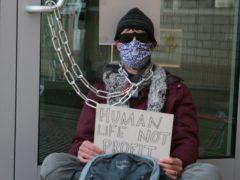Protesters gathered outside AstraZeneca's HQ in Cambridge (Luciana Guerra/PA)