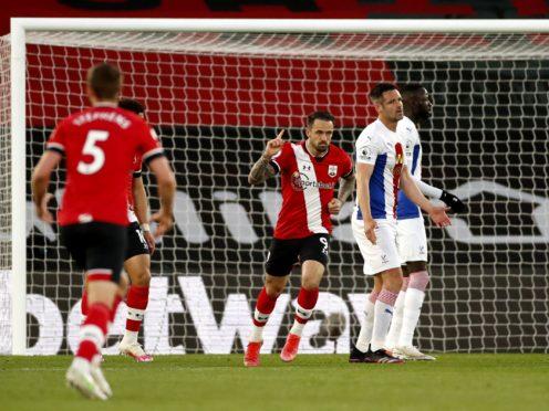 Danny Ings, centre, celebrates scoring Southampton's first goal (Andrew Boyers/PA)