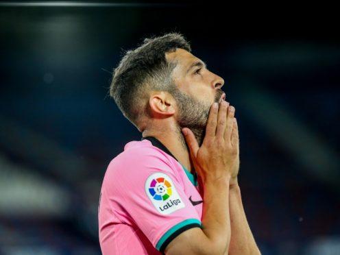 Jordi Alba looks dejected (Alberto Saiz/AP)