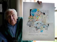 Artist Robert Seaman holds up the 365th daily doodle sketch in his room at an assisted living facility in Westmoreland, New Hampshire (Charles Krupa/AP)