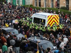 Protesters blocked in a Border Force van on Kenmure Street, Glasgow (Andrew Milligan/PA)