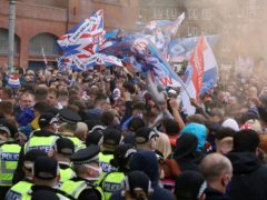 Rangers fans and police outside Ibrox (PA)