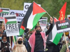 Demonstrators walk through Hyde Park as they make their way to the Israeli embassy in London (Dominic Lipinski/PA)